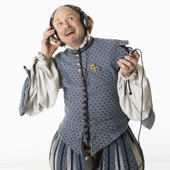 Shakespeare listening to headphones.