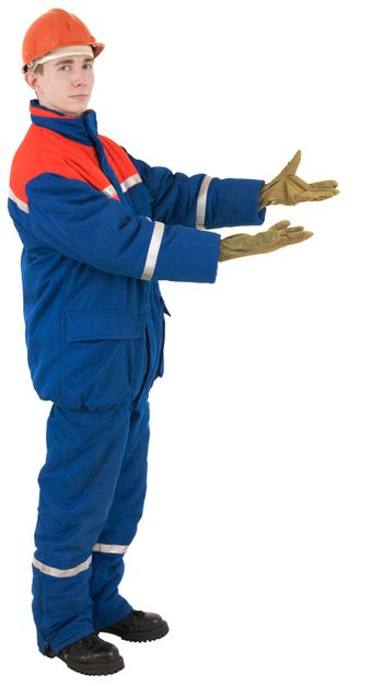 Worker in overalls and a helmet