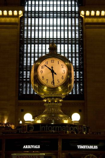 The old antique clock in the center of grand central station in New York City.