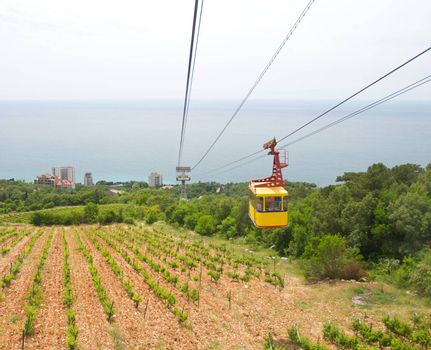 rope-way with tram from mountain to sea