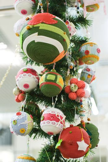 Close-up Christmas Toys and Balls on the fir tree