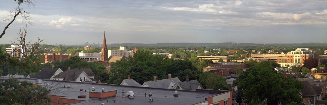 A wide angle panoramic view of downtown New Britain Connecticut with the Hartford skyline also visible far off in the distance.