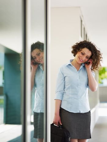 mid adult businesswoman on the phone