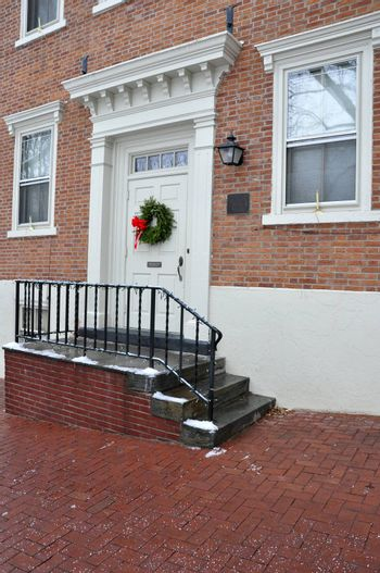front doors for a red brick house with wreaths on door
