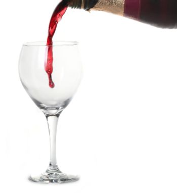 Red Merlot Wine Pouring into a Chilled Glass