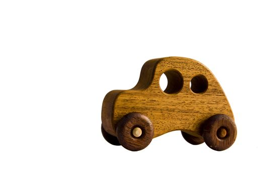 A funky wooden retro toy car with clipping path