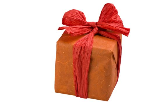 gift wrapped in orange paper with a red bow