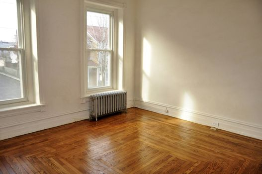 empty room in an old house with hardwood floor
