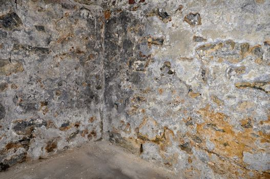 an abstract view of old stone walls in an old basement
