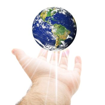 A hand being held out with the earth hovering above.  Earth source image courtesy of NASA.