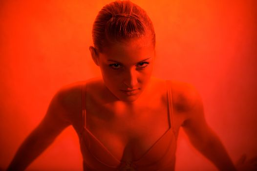 Young sexy woman portrait, red light