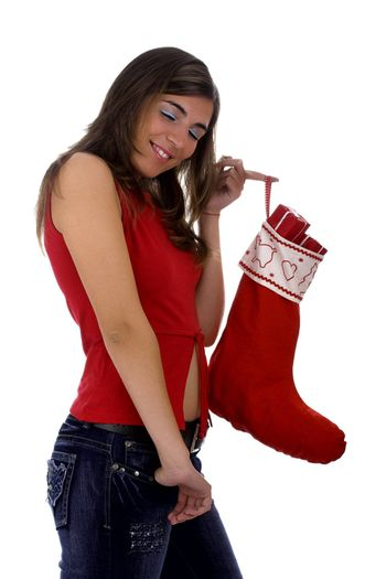 Christmas season! Different poses of a beautiful woman with a Christmas Socks full of small gifts inside.