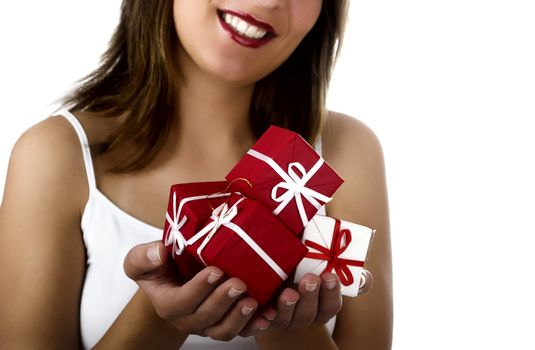 Christmas season! Different poses of a beautiful woman with small gifts on the hands.  (Focus is especially on the gifts)