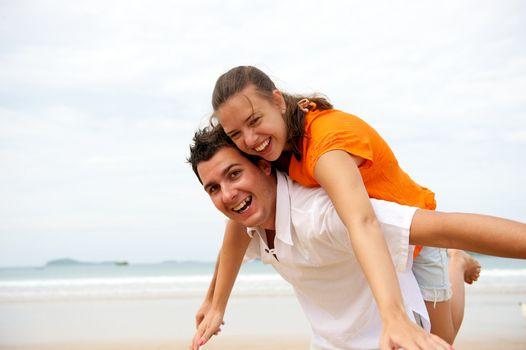 Younf couple enjoying the beach in Brazil