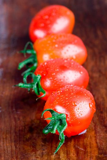 four wet tomatoes