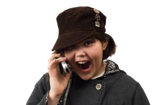 Young girl looking excited while talking on a cell phone, isolated against a white background