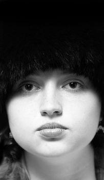 Black-n-white woman portrait in black fur-cap