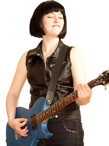 Young woman plays on a electric guitar