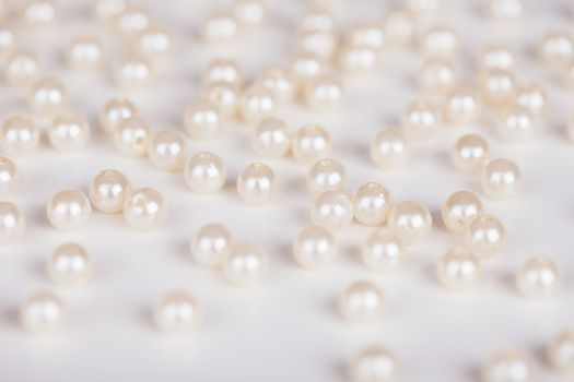 Scattering of fake pearls