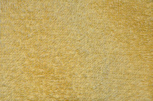 closeup abstract of texture for a yellow towel