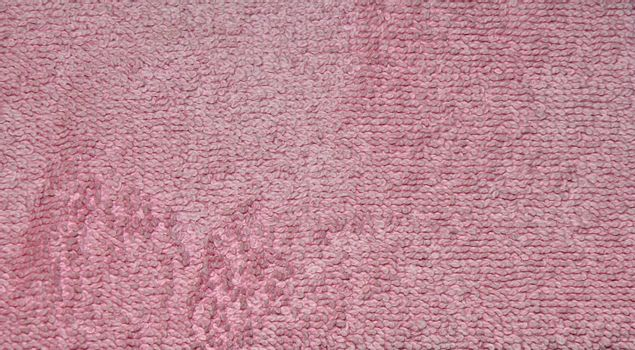 closeup abstract of a texture for a pink towel