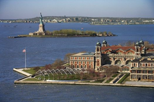 Aerial view of Ellis Island with Statue of Liberty, New York City.