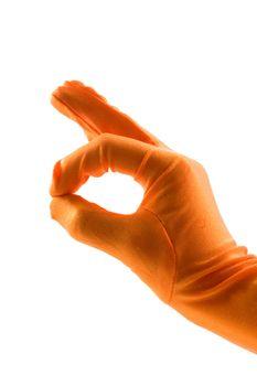 hand in orange glove is making the ok sign