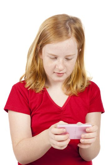 little girl is text messaging on a pink phone