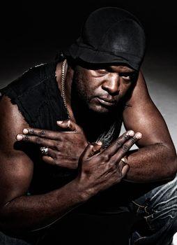 Black gangster men ready to fight on dark background