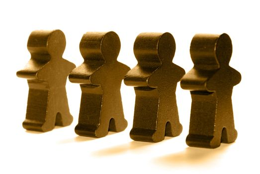 Wooden people standing in a line