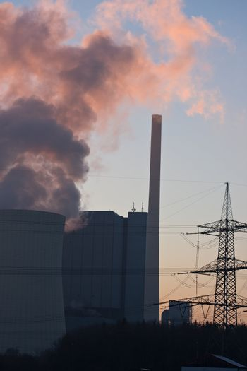 pink smoke from a power plant at sunset