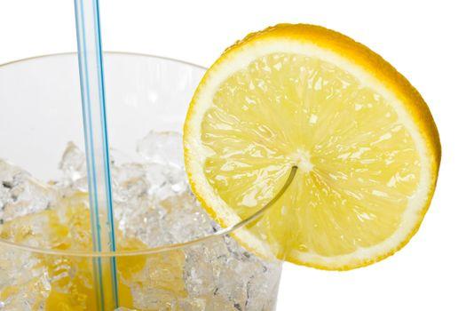 glass of orange juice with lemon slice and straw
