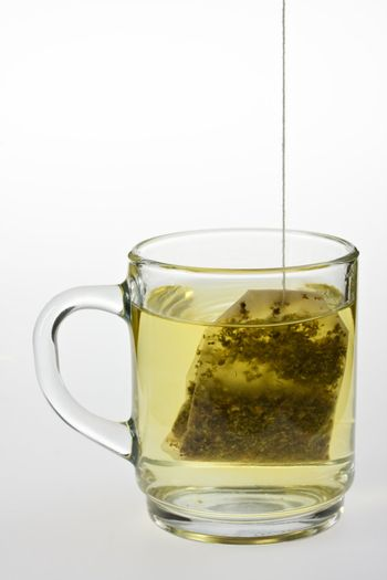 glass of herbal tea isolated on white