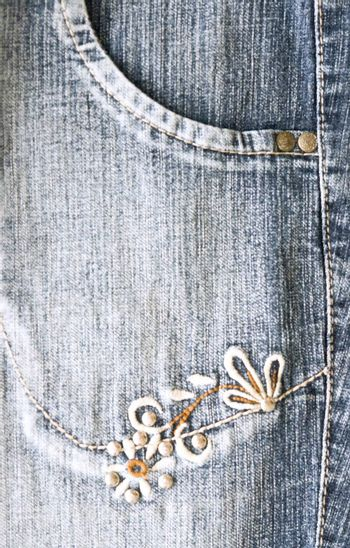 blue jean texture with flowers design. photo image