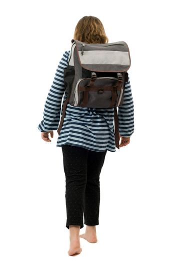 A young girl walking to school with no shoes on, isolated against a white background