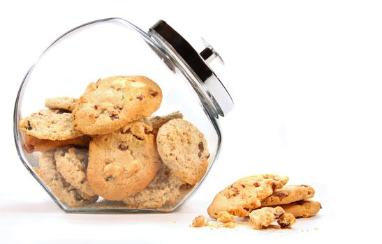 Glass  jar with cookies against a white