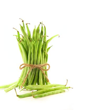 Unwashed green beans tied with cord on white