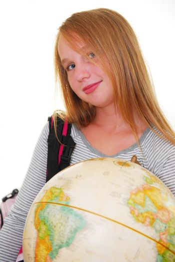 Young smiling girl with a backback and a globe isolated on white background
