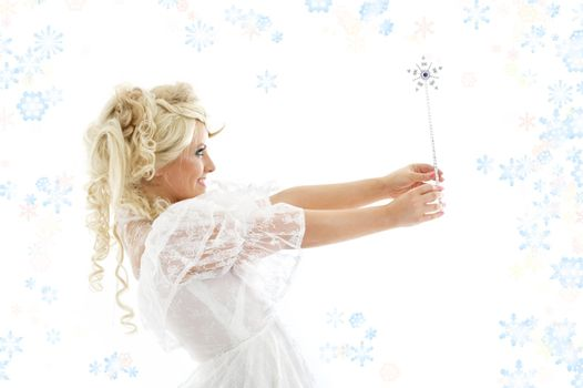 fairy with magic wand and snowflakes