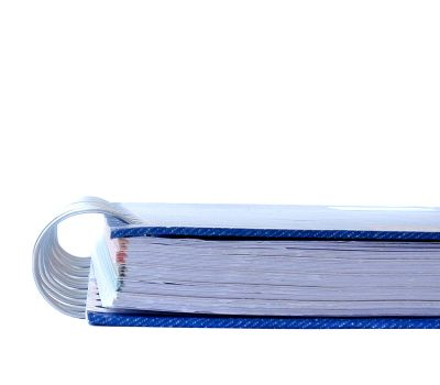 close notebook with blue jean texture cover on white background