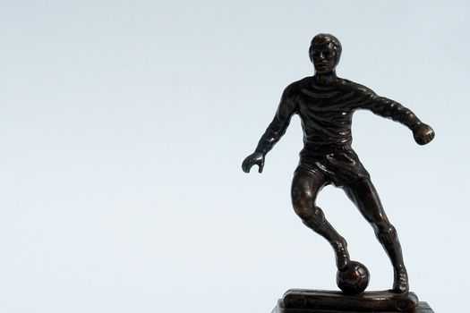 figure of man playing soccer on white background