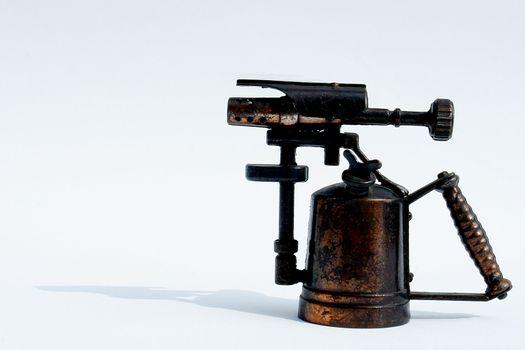 old spray bronze gun on white background