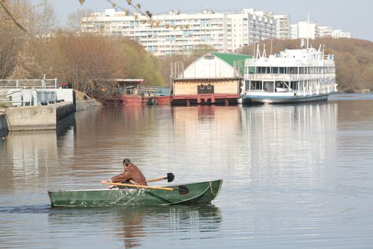 Man in Green Boat