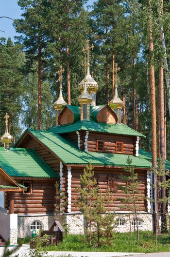 Wooden orthodox church among the trees