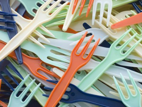 Pile Of Coloured Plastic Take Away Forks