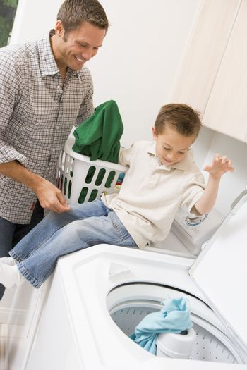 Father And Son Doing Laundry