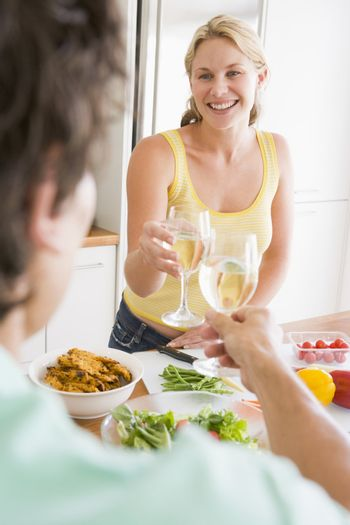 Woman Talking To Husband While Preparing meal,mealtime