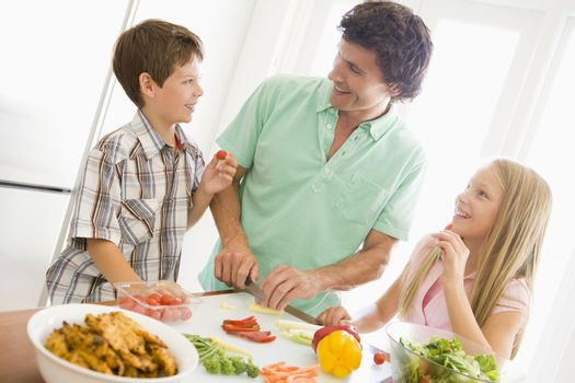 Father And Children Prepare A meal,mealtime Together