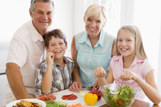 Grandparents And Grandchildren Prepare A meal,mealtime Together