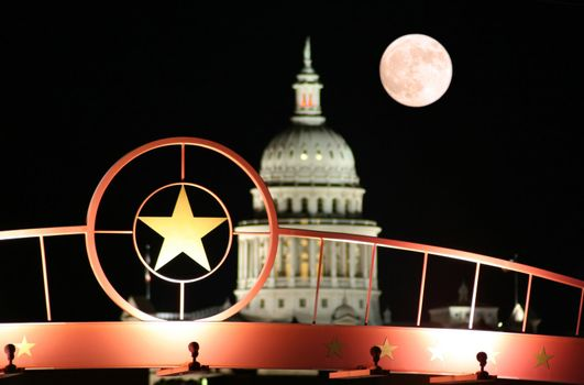 Star of Texas with the State Capitol Building at Night